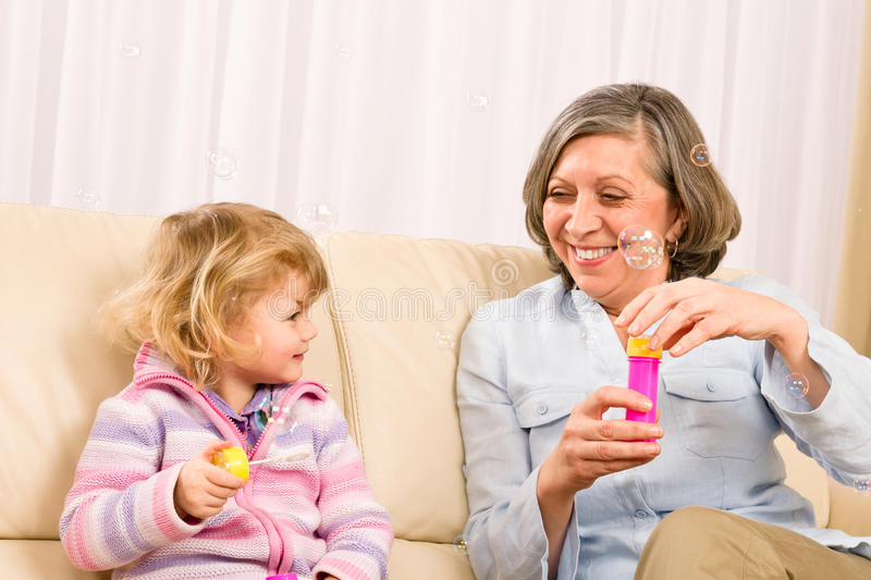 Download Little Girl With Grandmother Play Bubble Blower Stock Photo - Image: 23458810
