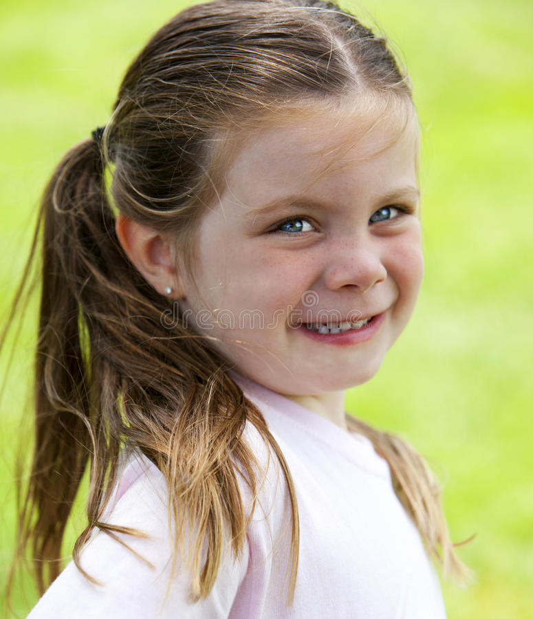 Download Little girl in grass stock photo. Image of laughing, sunny - 25841046