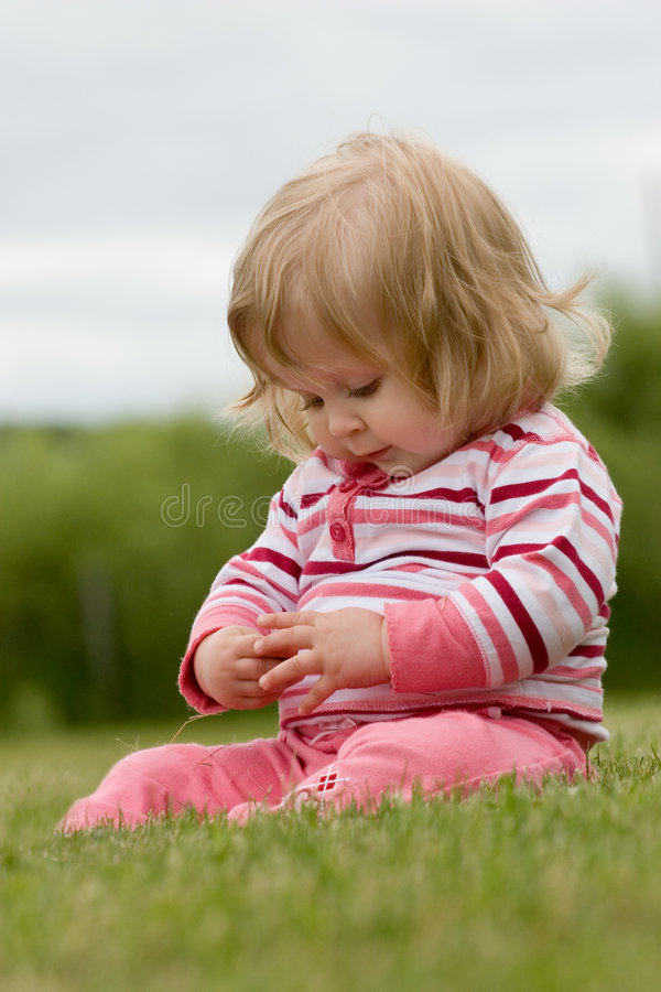 Little Girl in the Grass stock photo
