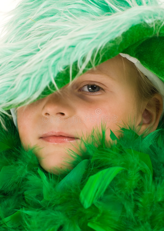 Download Little girl in green stock image. Image of feathers, cute - 4733293