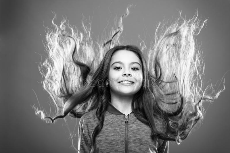 Little girl grow long hair. Teaching child healthy hair care habits. Strong hair concept. Kid girl long healthy shiny. Hair. Main thing is keeping it clean. Use royalty free stock images