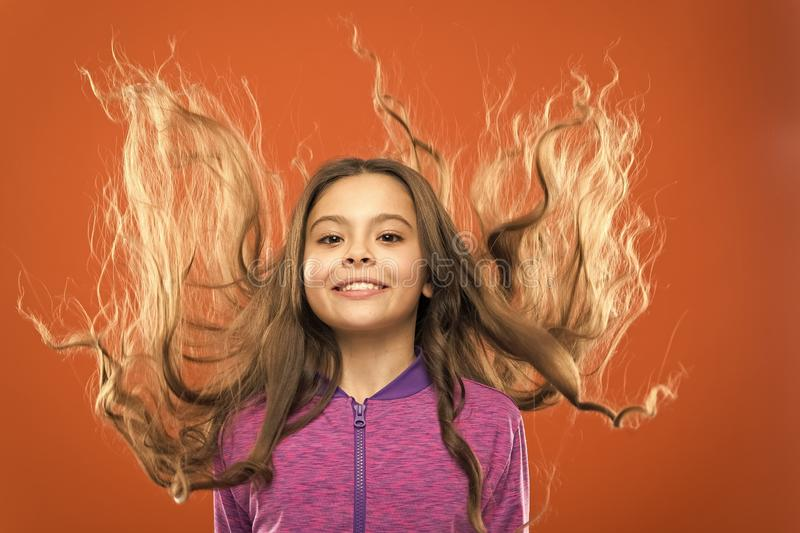 Little girl grow long hair. Teaching child healthy hair care habits. Strong hair concept. Kid girl long healthy shiny royalty free stock photo