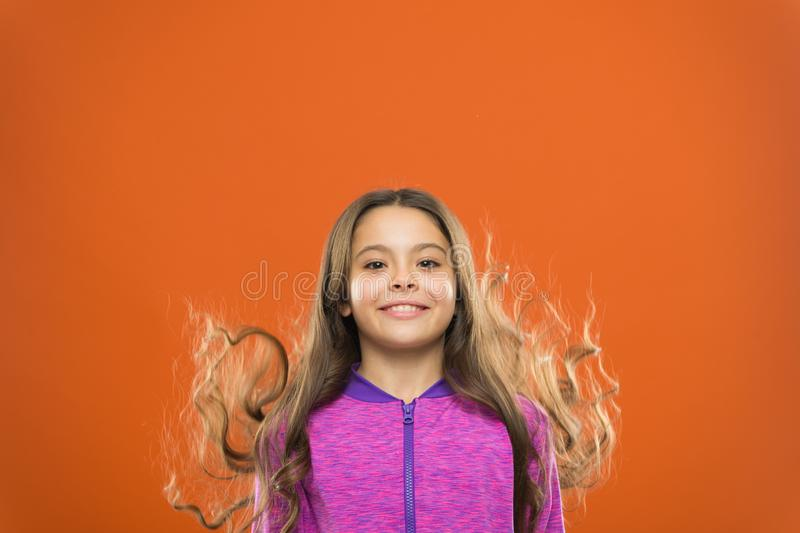 Little girl grow long hair. Teaching child healthy hair care habits. Strong hair concept. Melanin substance give pigment. Person with brown has much more stock photography