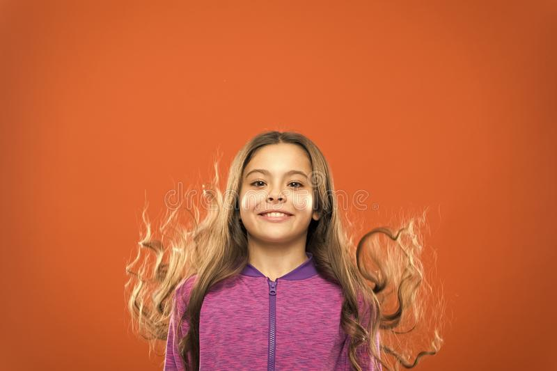 Little girl grow long hair. Teaching child healthy hair care habits. Strong hair concept. Melanin substance give pigment royalty free stock photo