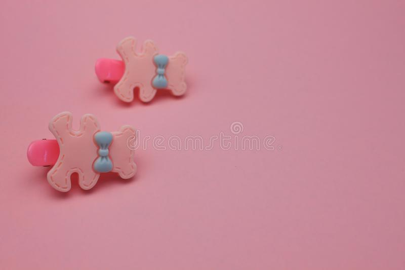 Little girl hair accessories on a pink background. Cute girlish clips for stylish hairstyles stock photography