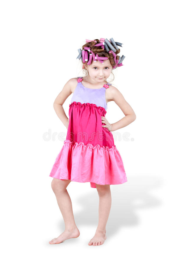 Little Girl With Hair-curlers In Her Hair Poses Royalty Free Stock Photo