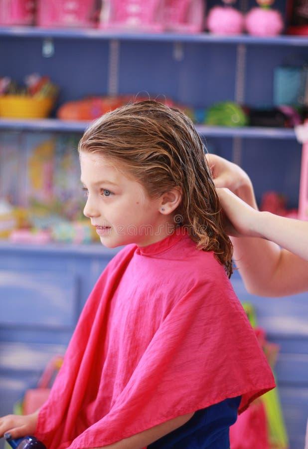 Little girl haircut royalty free stock photo