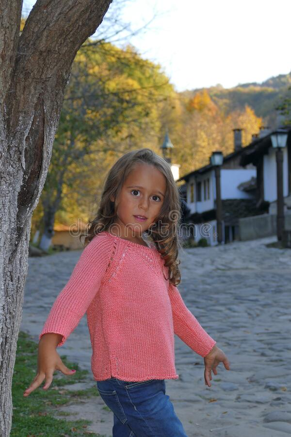 Little girl, 4 and a half years old, poses as a model in a mountain village. In Bulgaria royalty free stock image