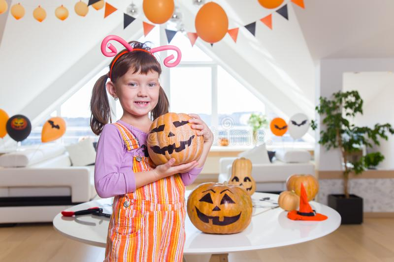 Little girl  in Halloween party stock images