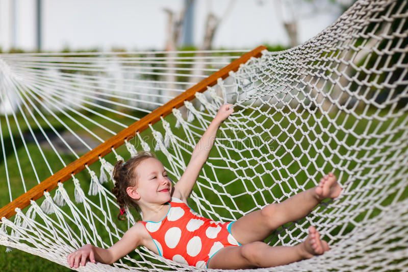 Little girl in hammock stock image
