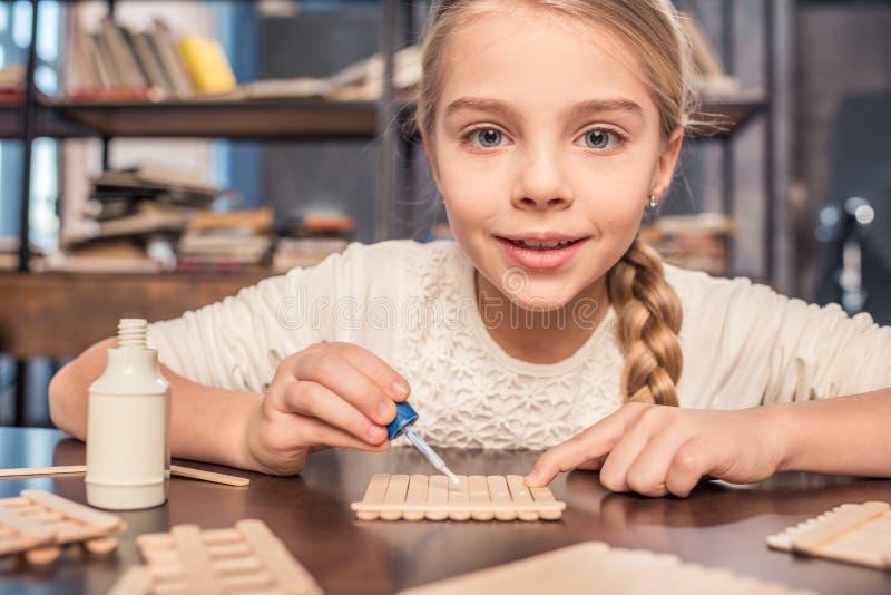 Little girl handcrafting stock photo