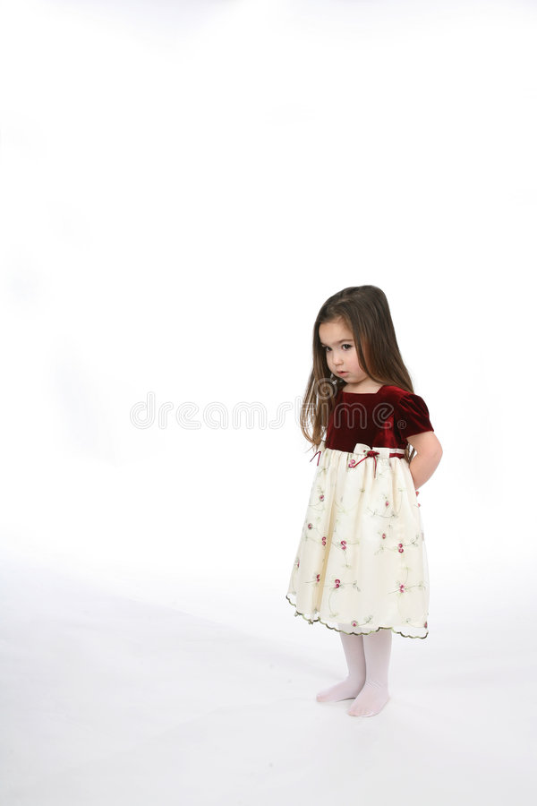 Little girl with hands behind her back royalty free stock images