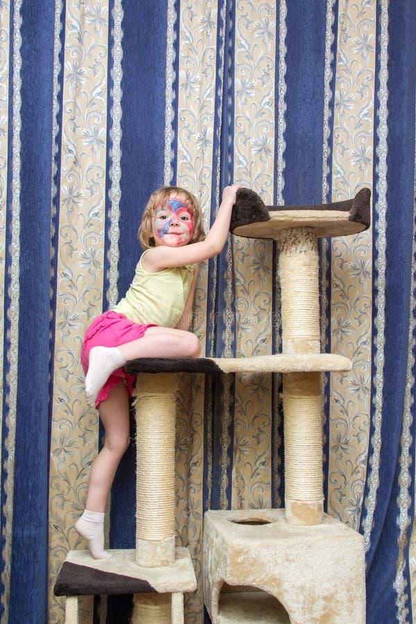 Little girl hanging on cat Climbing frame. Little girl hanging on a cat Climbing frame stock images