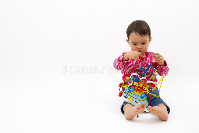 Little girl happy with colorful wooden Toys isolated on white background royalty free stock images