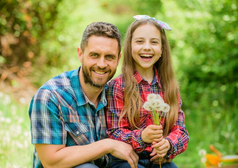 Little girl and happy man dad. earth day. family summer farm. spring village country. daughter and dad love dandelion stock image