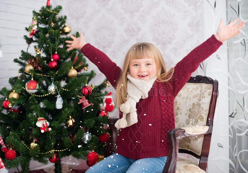 Little girl is happy in the New Year. royalty free stock photo