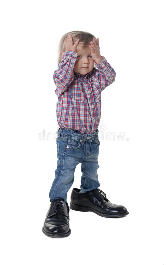 Little girl has big shoes royalty free stock photography