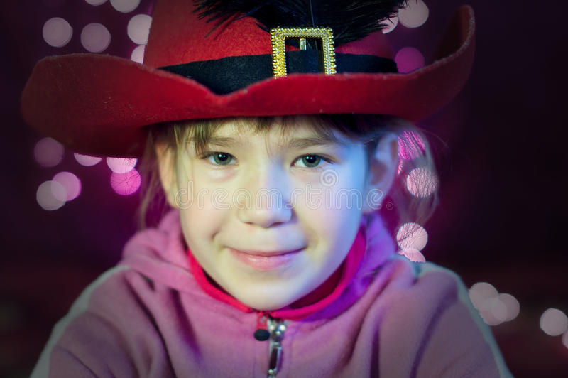 Download Little Girl With Hat Look With Christmas Lights Royalty Free Stock Images - Image: 22589339
