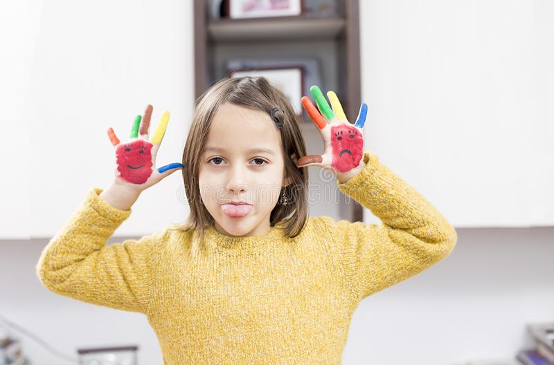 Little girl have fun with colored hand royalty free stock photos