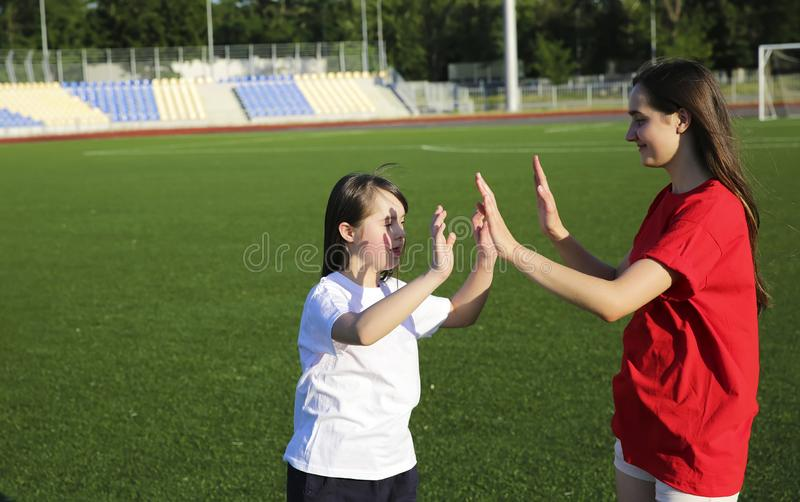 Little girl have fun on the stadium royalty free stock image