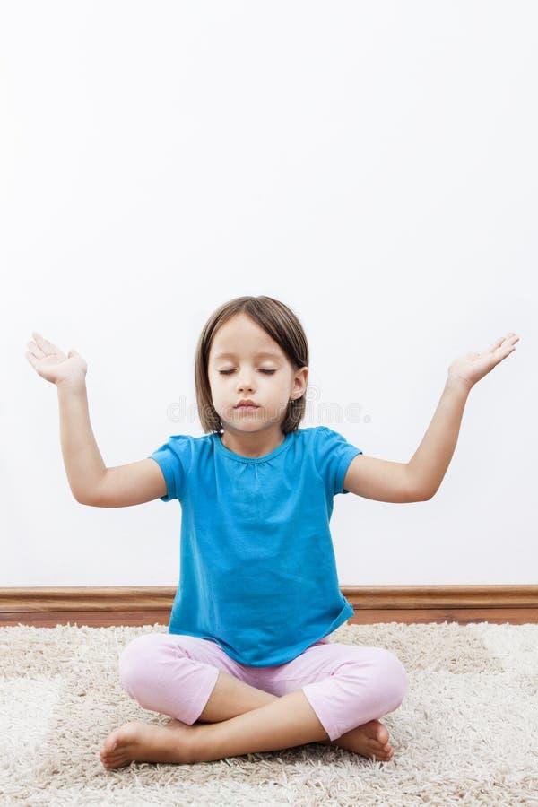 Little girl have meditation stock images