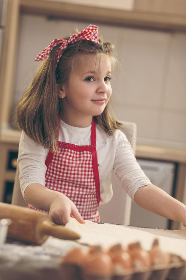 Little girl making pizza dough royalty free stock image