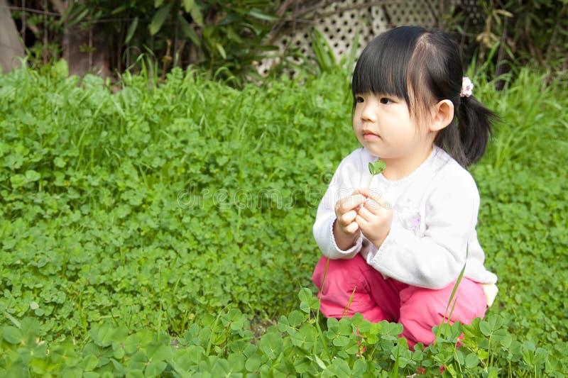 Little girl having fun in park royalty free stock photos