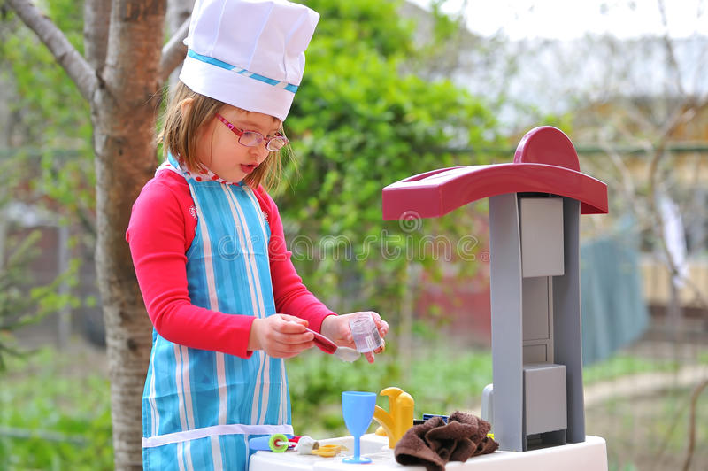 Download Little Girl Having Fun Playing Cooking Stock Image - Image of playing, cook: 19227919