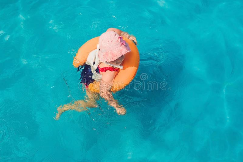 Little Girl having fun in the water park royalty free stock image