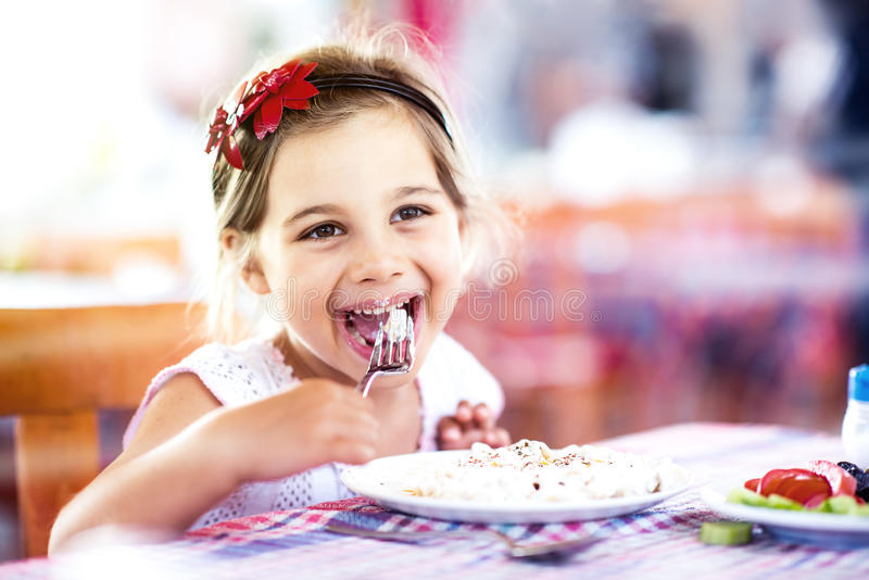 Little Girl Having Her Meal royalty free stock image