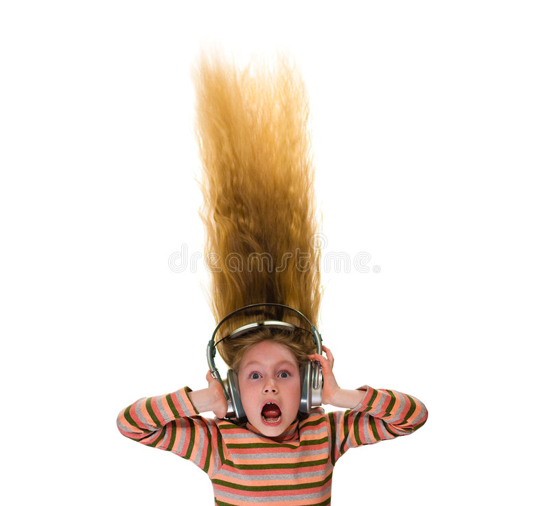 Little girl with headphones and her hair stood on stock image