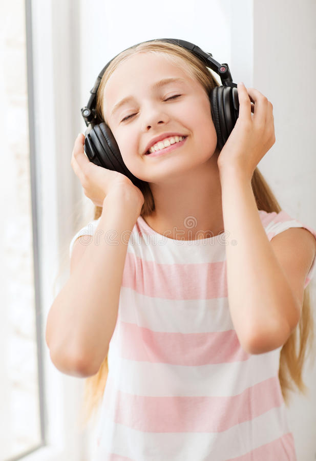 Little Girl With Headphones At Home Royalty Free Stock Photo
