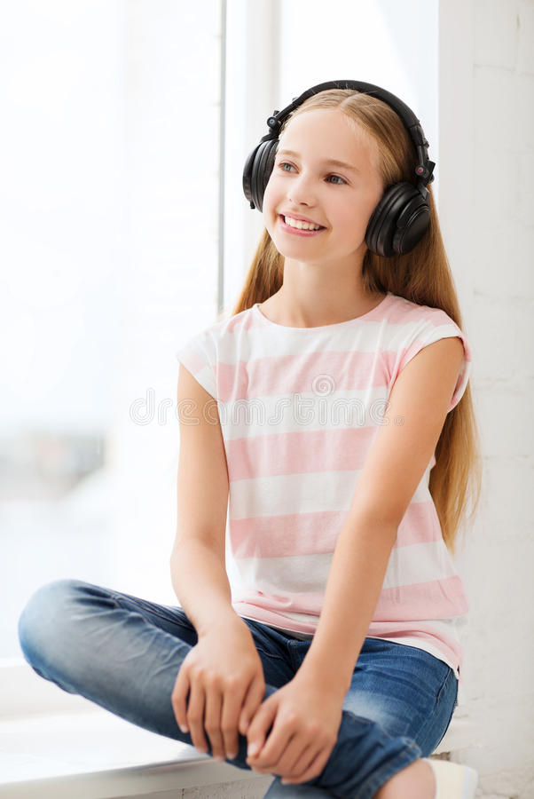 Download Little Girl With Headphones At Home Stock Image - Image: 34953039