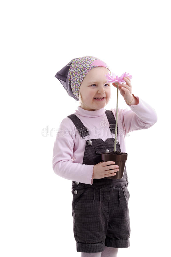 Little Girl With Headscarf & Pink Flower Royalty Free Stock Image