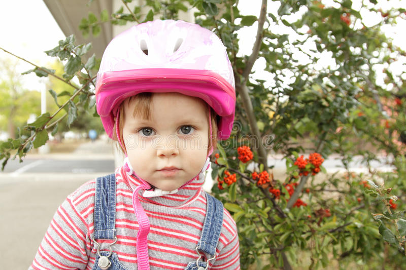Little Girl With Helmet Stock Photos