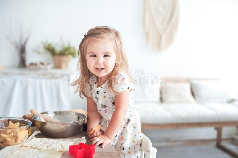Relationship in the family with small children. Little girl help cooking, concept of love and family well-being royalty free stock image
