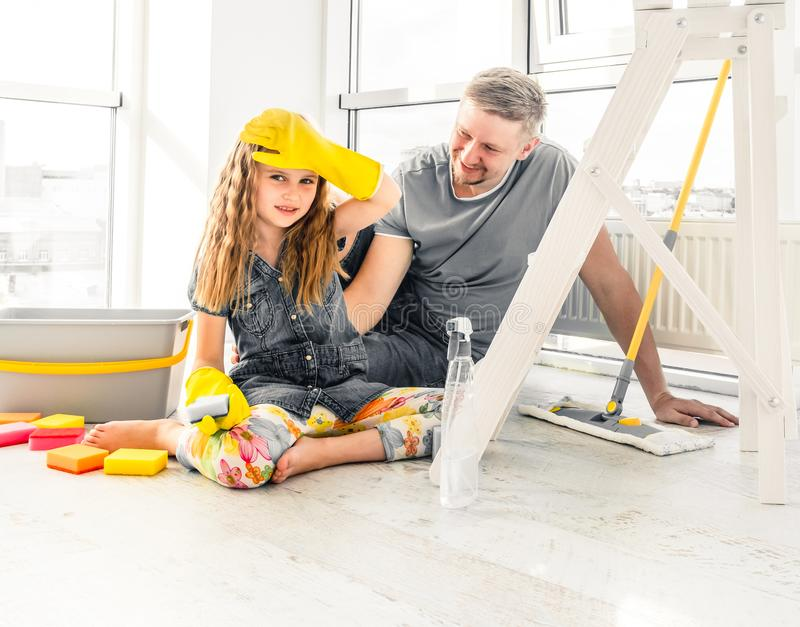 Little girl helping dad at cleaning royalty free stock photography