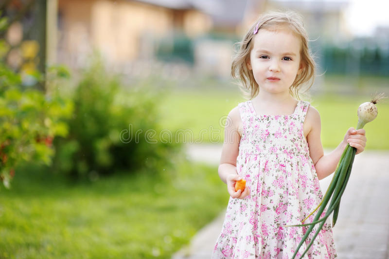 Little Girl Helping In A Garden Stock Photography