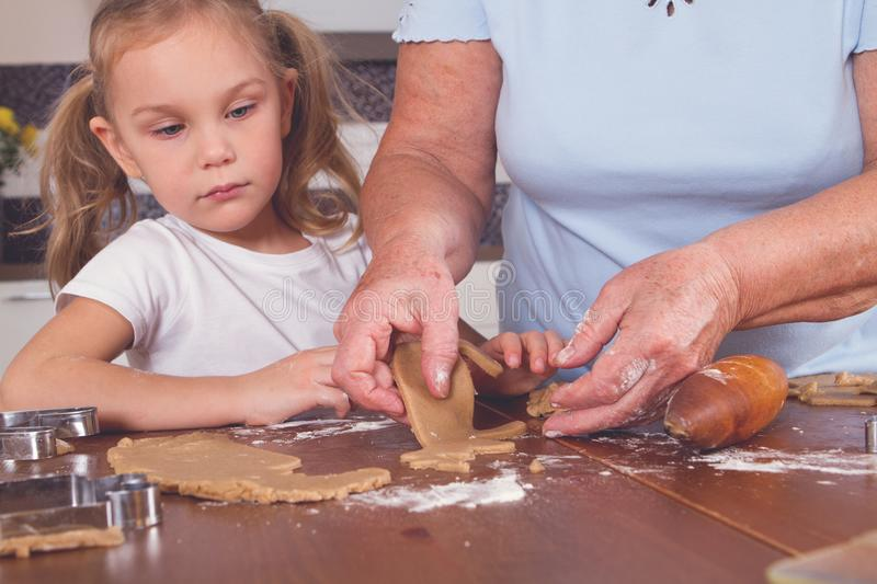 Grandmother and granddaughter cook royalty free stock photos