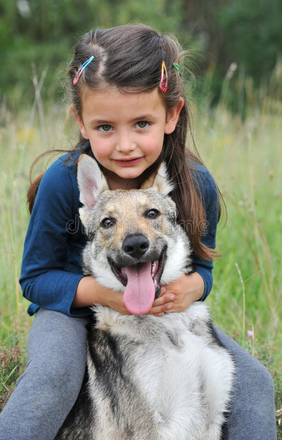 Little Girl And Her Baby Wolf Dog Stock Photo - Image of ...