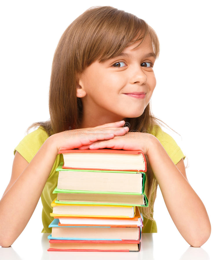 Little girl with her books. Portrait of a little girl with her books, isolated over white royalty free stock photos