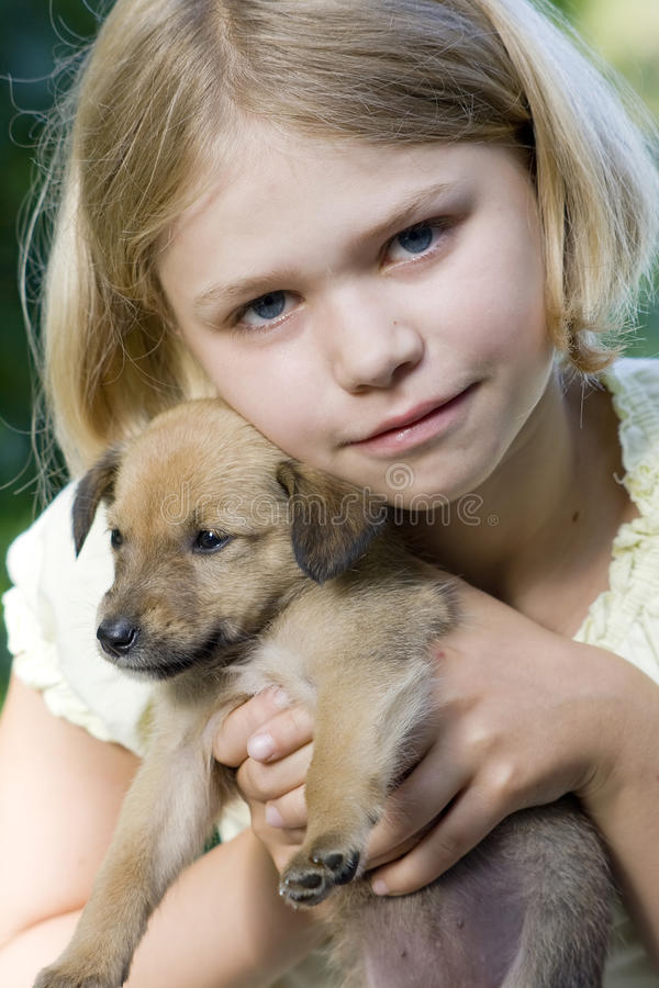 Little girl and her dog royalty free stock images
