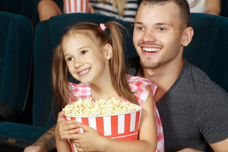 Little girl and her elder brother at the cinema stock photo