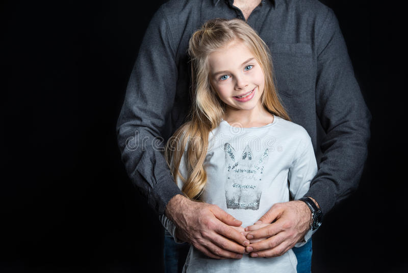 Little girl with her father stock photos