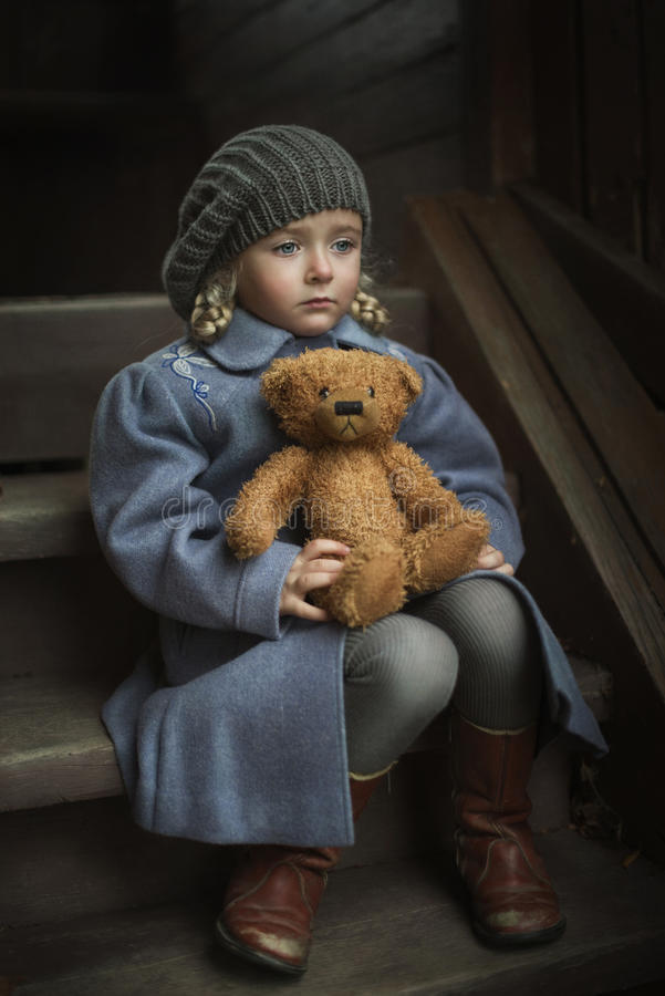 Little girl with her favorite toy royalty free stock photo