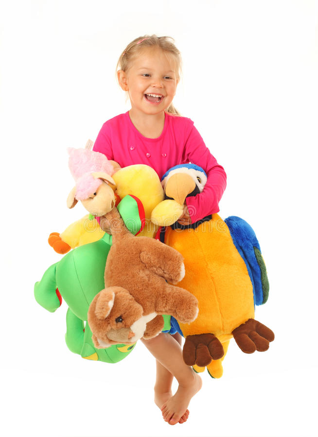 Download Little Girl With Her Favourite Toys Stock Photo - Image of soft, white: 43262330