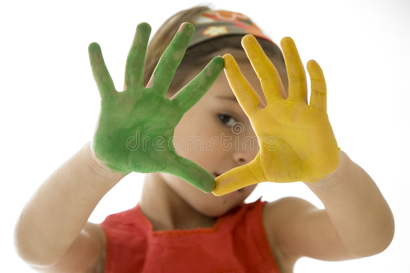 Little girl with her hands painted stock images