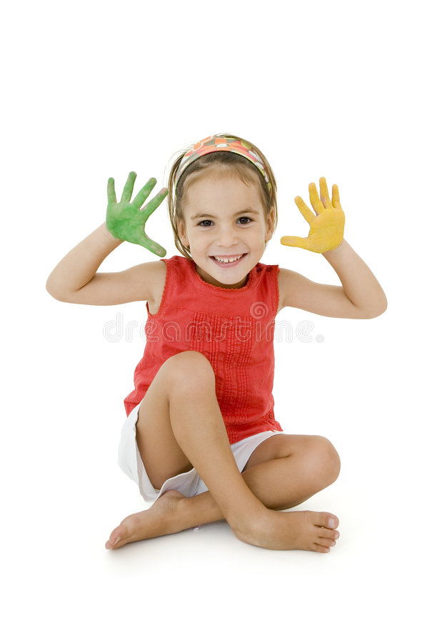 Little girl with her hands painted stock image