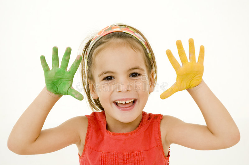 Little girl with her hands painted royalty free stock image