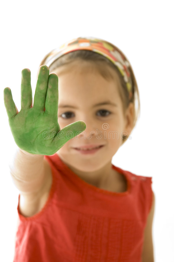 Little girl with her hands painted stock photos